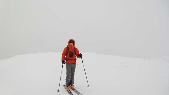 Ben approaching the summit of White Lupine Ridge. Not the greatest weather...