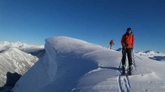 Traversing beside the huge summit cornice