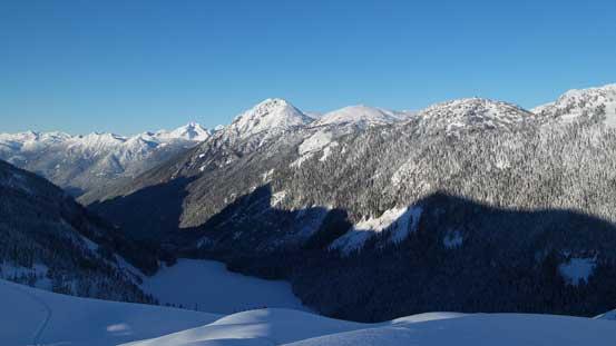 Prior Peaks rise behind the frozen Lizzie Lake