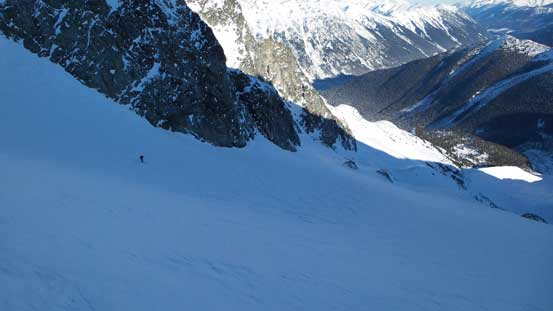 Skiing down Anniversary Glacier