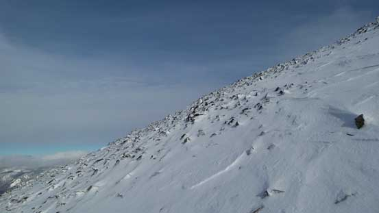 The upper mountain is a plod on frozen scree