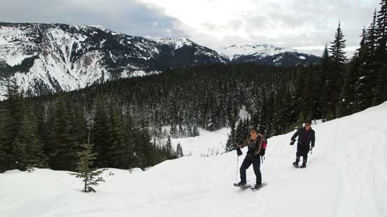 My parents snowshoeing up the cutblock