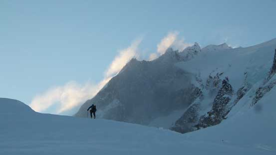 Alex ascending towards Warren Glacier with the massive peak in the background