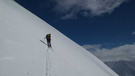 Alex skinning up the big slope.
