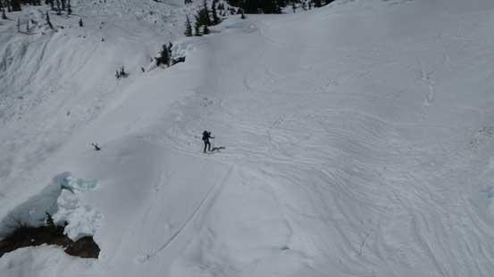 Alex skiing down the last roll.