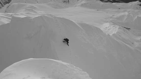 Here's Alex down-climbing into the notch separating the false summit with the true summit