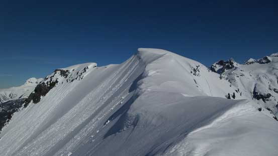 The final summit ridge traverse. Note the cornices