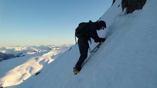 Alex down-climbing/traversing the upper west face
