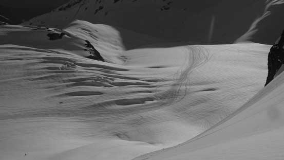 The highway of snowmobile tracks and the crevassed headwall