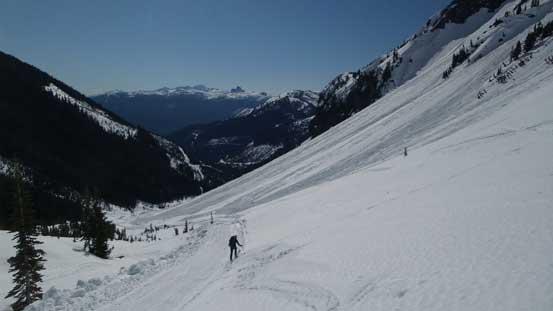 Skiing down into the bowl on some slushy snow