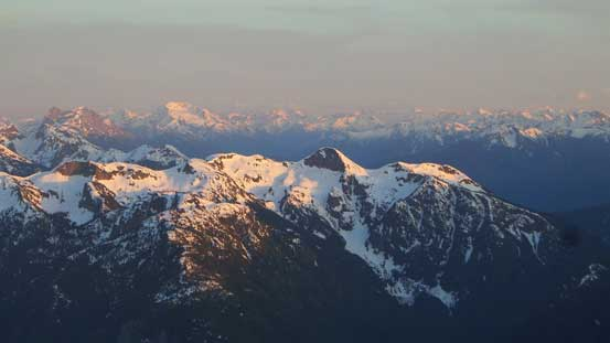 Looking over the summit of Marmot Mountain towards distant giants in the North Cascades