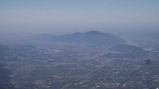 Looking down at Sumas Mountain and the city of Abbotsford. It was a bit hazy.