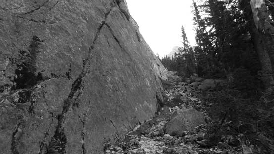 Here the trail parallels that slab wall for a long while