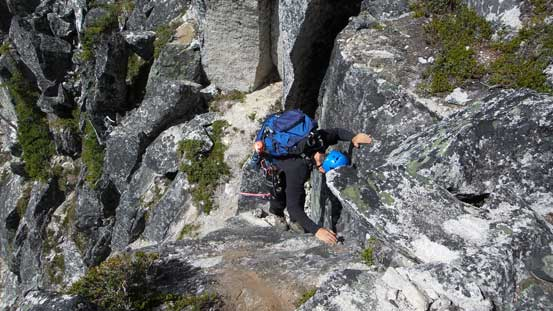 The other climber down-climbing the crux