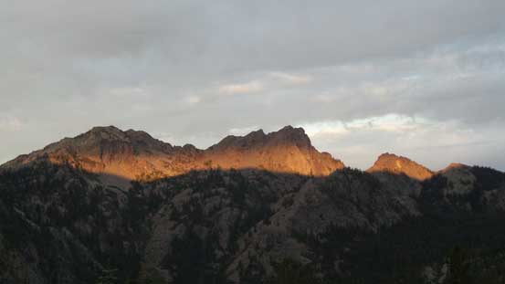 Alpenglow on the nearby walls. I don't think that peak has a name though.