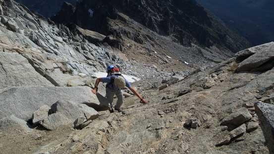 Ascending the last few meters to the shoulder below false summit