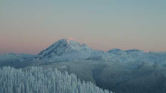 The tip of Atwell Peak catches the glow