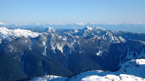 This is looking over the Mt. Seymour/Mt. Elsay group, towards distant peaks by Chilliwack area