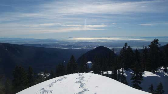 Looking back at the Lower Mainland. Lynn Peak is that dark triangular face.